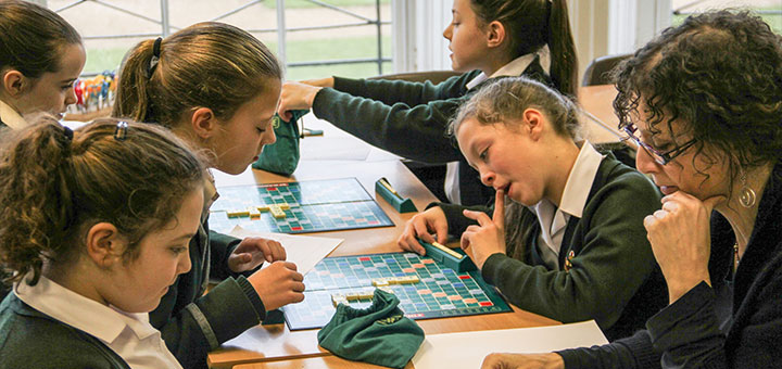 Oakwood pupils playing scrabble